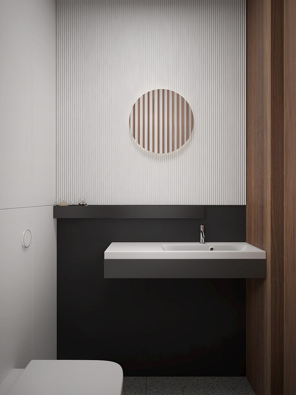 18 aranzacja wnetrza M563 mieszkanie katowice toaleta czarno biala scian z bialymi lamelami wiszaca umywalaka czarne dodatki