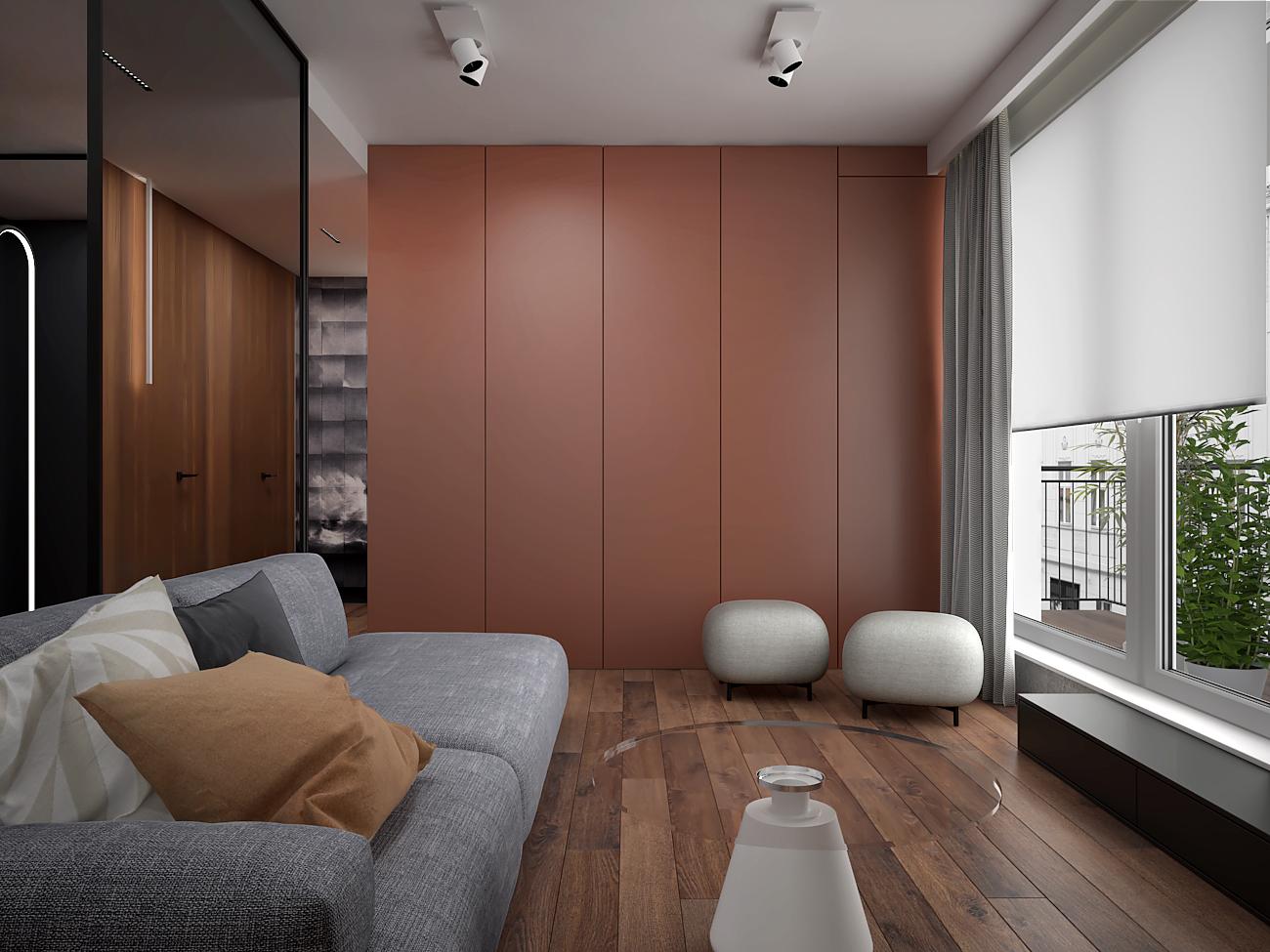 2 aranzacja wnetrza M563 mieszkanie katowice salon szara sofa dwie pufy szklana sciana siana z lakierowanej plyty meblowej