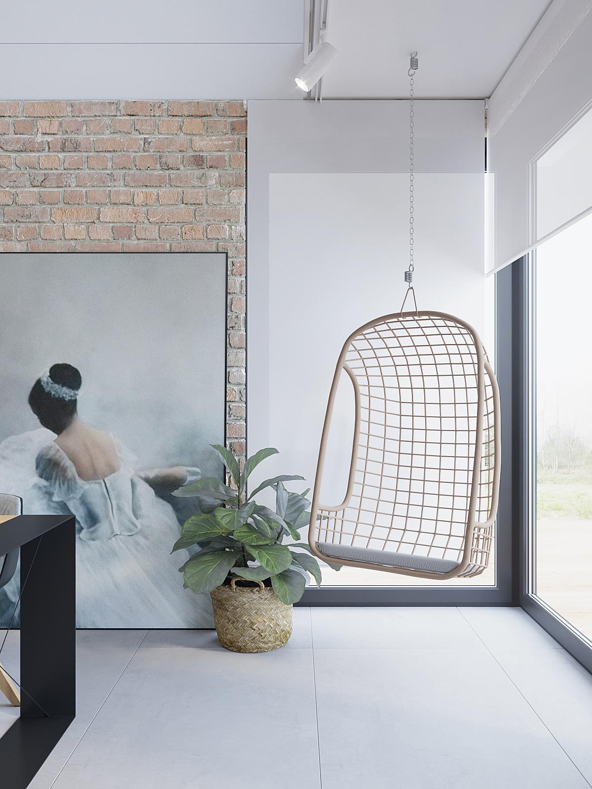 15 architekt wnetrz D428 dom Ruda Slaska salon wiszacy fotel cegal na scianie obraz z baletnica