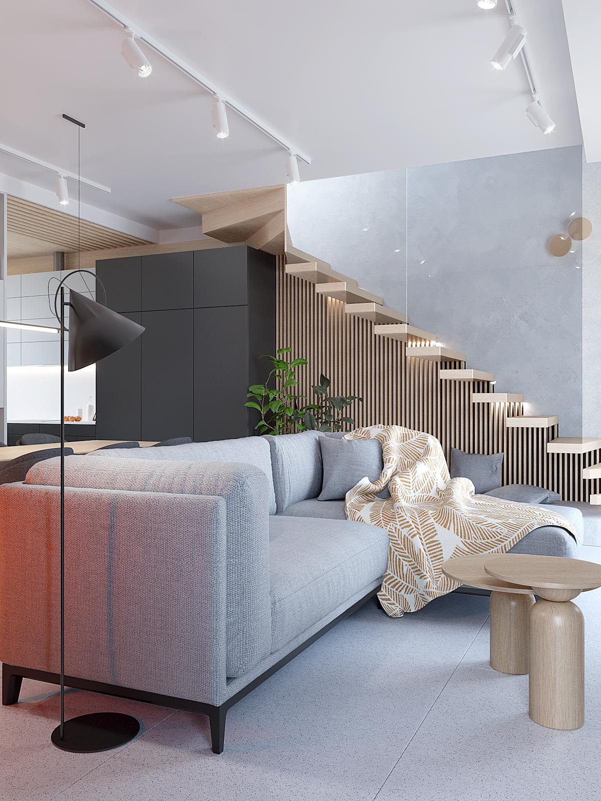 2 aranzacja wnetrz D395 dom Tychy salon szara sofa sare plytki w salonie drewniane schody lampa podlogowa