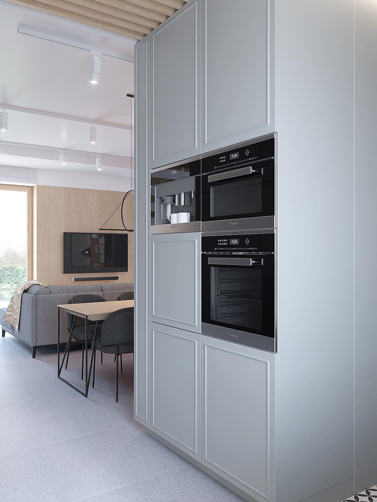 5 aranzacja wnetrz D395 dom Tychy kuchnia wysoka zabudowa z piekarnikiem biale fronty frezowane telewizor na drewnianej scianie