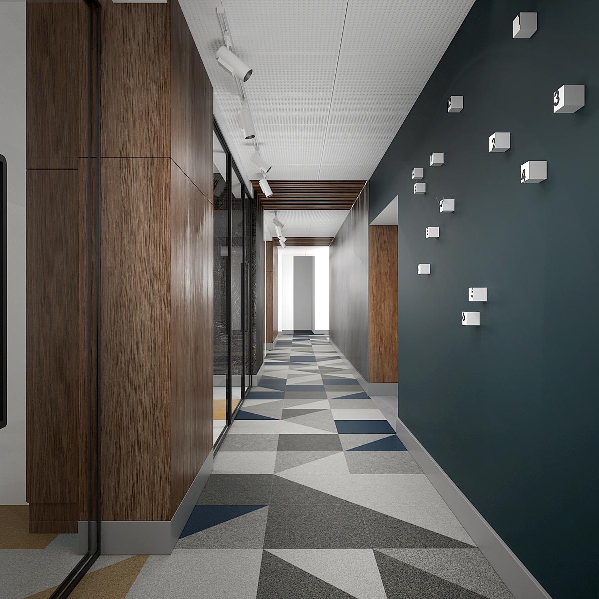 7 projekt biura B247 Kancelaria warszawa korytarz wykladzina w geometryczne wzory plyta meblowa na scianie zegar scienny