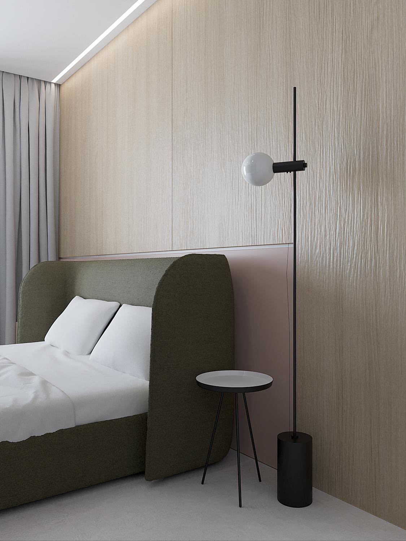 11 projket wnetrza M558 sypialnia zielone lozko drewniana sciana lampa stojaca przy lozku