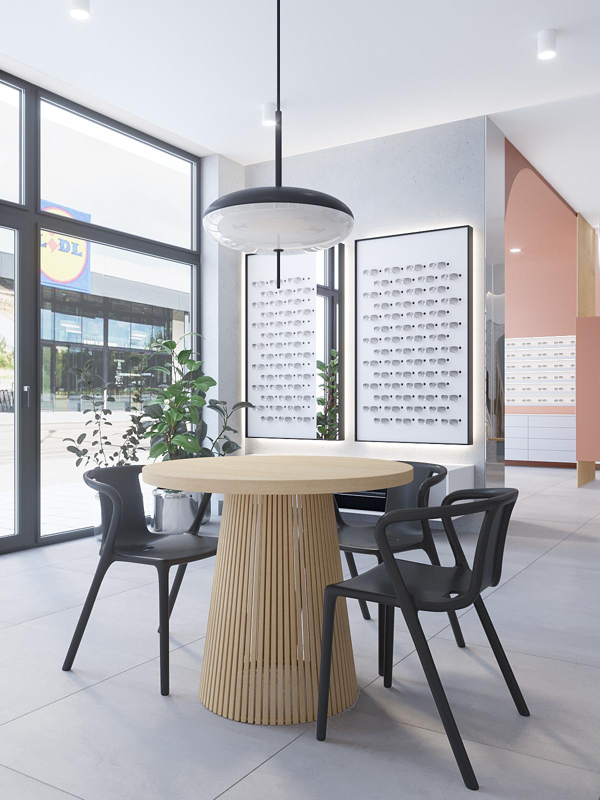 5 architekt wnetrz K099 optyk Strozik Bytom punkt obslugi klienta okragly stol czarne krzesla rozwy akcent na scianie betonowe plytki