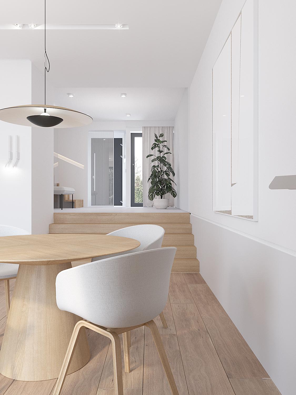 11 projekty wnetrz D495 dom Krakow jadalnia krzesla kubelkowe biale drewniany stol okragly stol na jednej nodze drewniana podloga schody w salonie