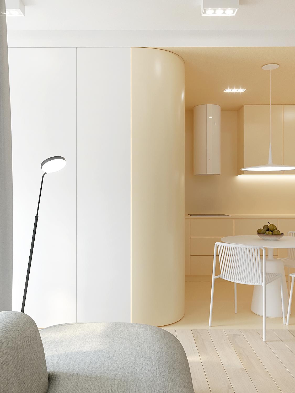 4 aranzowanie wnetrz M378 mieszkanie Katowice kuchnia z salonem szara sofa zlota zabudowa oble katy lampa stojaca przy sofie